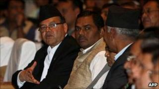 Nepalese Prime Minister Jhalnath Khanal (L), ministers and lawmakers attend a parliament session in Kathmandu on 28 May 2011