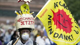 "A demonstrator carries a flag reading ""nuclear power? no thank you!"" during a protest in Berlin, Germany, 28 May 2011"