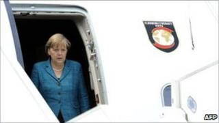 File picture of German Chancellor Angela Merkel disembarking from a plane after landing in France on 26 May 2011