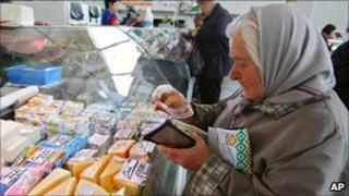 Belarusian woman buying cheese at a market in Minsk