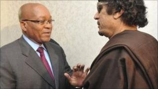 South Africa's President Jacob Zuma (L) greets Libyan leader Muammar Gaddafi - 30 May 2011