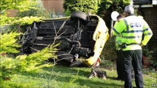 Overturned car after police crash