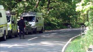 Police vans near Woodsome Hall Golf Club, Huddersfield