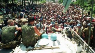 Dutch UN peacekeepers watching Muslim refugee near Srebrenica, on 13 July 1995