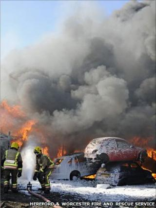 Firefighters tackle a blaze at a scrapyard in Hereford
