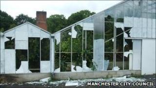 Smashed windows of aviary at Wythenshawe park