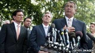 John Boehner along with House Republicans speaking outside the White House