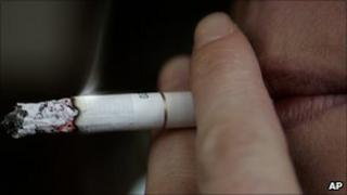 A smoker takes a drag