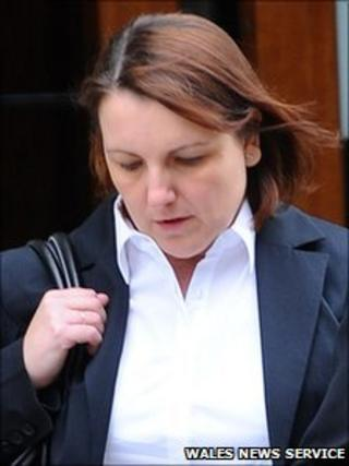 Joanne Evans leaves the hearing in Cardiff on Wednesday