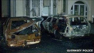 Burnt out cars by the Mandarin Car Park, Cobo, Guernsey