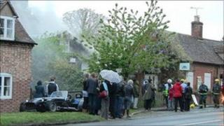 Villagers outside the burning hall in Nuneham Courtenay