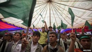 Supporters of Afghanistan's former intelligence chief, Amrullah Saleh, wave green flags during a gathering in Kabul May 5, 2011