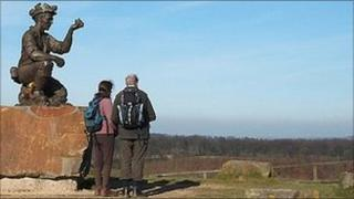 Two amateur surveyors look out across Nottinghamshire from the top of the Silverhill Wood. Photo: John Barnard