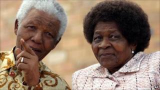 Nelson Mandela (left) talking to Albertina Sisulu in 2005