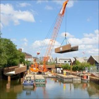 The 10.6-tonne bridge being lifted into place