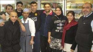 Abdul Arain (far right) with staff at his Cambridge delicatessen