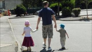 A man with two children