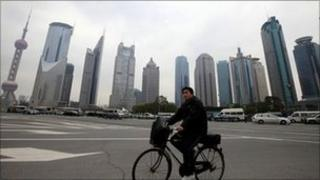 man riding bike in china