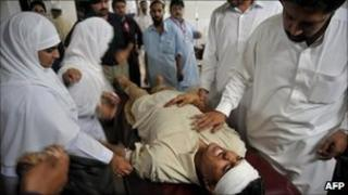 An injured blast victim in a hospital in Peshawar after a bomb in Nowshera, 5 June 2011.
