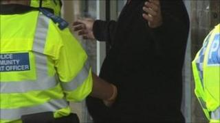 Man being searched by police on Saturday