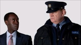 Brendan Gleeson with Don Cheadle (l) in The Guard