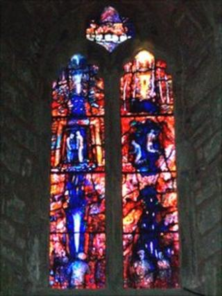 Freeminers stained glass window at St Michael's Church at Abenhall