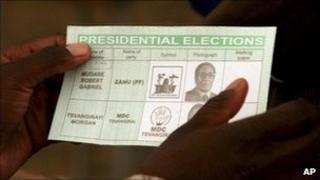 Voter holding ballot paper in 2008 poll