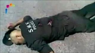 "A grab from footage aired on Syria's state television on 7 June 2011 shows what it said was a policeman shot dead by ""terrorist gangs"" during a massacre in the town of Jisr al-Shughour on 6 June 2011. NB: Independent reporting on the ground is not allowed, so it is impossible to verify the account of either side."