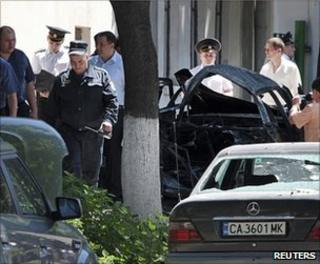 Moldovan security forces examine the scene of the blast in Chisinau, 7 June
