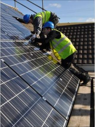 Dulas workers installing solar panels