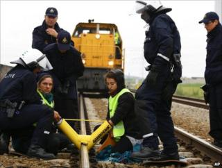 Police attempt to remove Greenpeace protesters chained to the rails near Borssele, 7 June