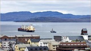 Hong Kong flagged Nordic Barents leaves Kirkenes in the north of Norway on route to China