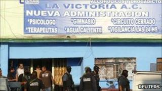 Police stand outside the rehabilitation centre in Torreon, 7 June 2011.