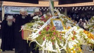 Photo released by Syria's official news agency said to show Syrian Druze clergymen praying over the coffin a Syrian policeman killed in Jisr al-Shughour, 7 June 2011