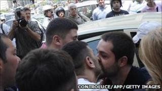 Mafia suspect kisses friend as he's taken to jail in Naples, Italy