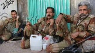 Soldiers rest while protesters celebrated after President Saleh left for Saudi Arabia