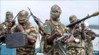 Masked gunmen on a boat in Nigeria