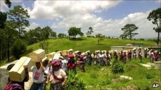 Relatives bury the exhumed remains of victims of Guatemala's civil war, Zacualpa, 2001