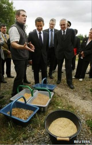 French President Nicolas Sarkozy listens to a cattle farmer at Montemboeuf, central France, 9 June