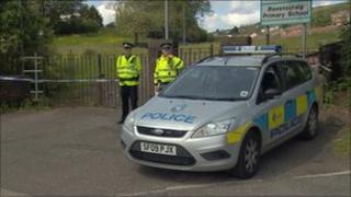 Police car at murder scene in Greenock