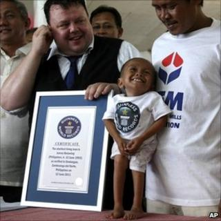 Junrey Balawing is presented with the Guinness World Records certificate declaring him the world's shortest man - 12 June 2011