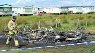 The remains of the caravan on Saturday