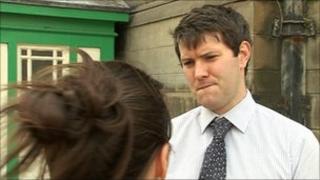 BBC political reporter James Vincent speaks to police officer