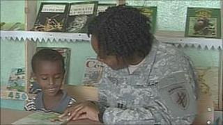 Capt Courtney Sanders teaching a child to read