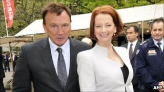 Australian Prime Minister Julia Gillard (R) and her partner Tim Mathieson stroll open air shops in Tokyo on April 22, 2011