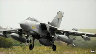 An RAF Tornado takes off from a base in Italy