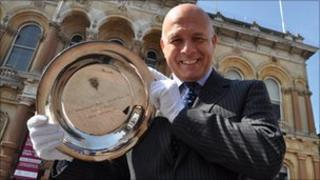 Terry Baxter holding a plate commemorating Ipswich's Uefa Cup tie with Inter Milan