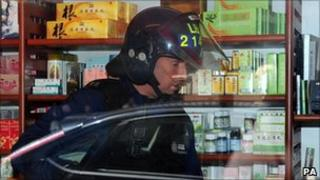 Police from the Border Agency raid a medical shop in Newcastle suspected of human trafficking