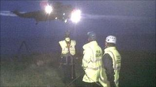 Tynemouth Volunteer Life Brigade members and rescue helicopter (pic courtesy of Tynemouth Volunteer Life Brigade)