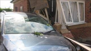 VW Passat after driving into a house